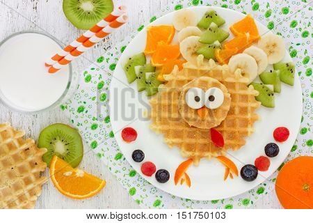 Thanksgiving healthy breakfast idea for kids - wafer turkey with kiwi banana orange fun food art idea for kids food top view