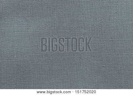 woven texture of new fabric or cotton material for a background or for wallpaper of dark silvery color