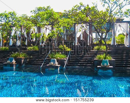 Nusa Dua, Bali, Indonesia - April 14, 2014: View of swimming pool at St. Regis Bali Resort