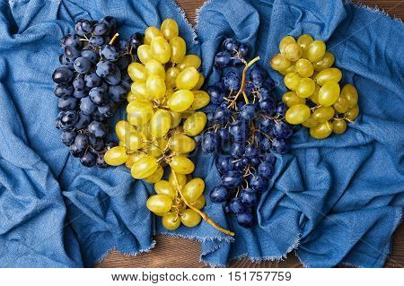 Blue and green grapes on towel top view