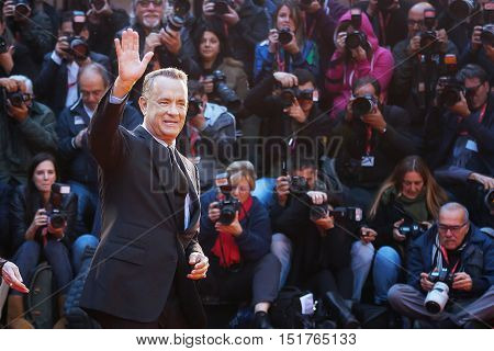 Rome, Italy - October 13, 2016: Tom Hanks on the red carpet at the 11th film festival in Rome greets the audience. American actor Tom Hanks on the red carpet greets the audience raising his arm.
