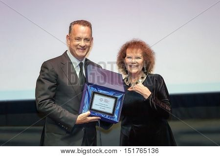 Rome, Italy - October 13, 2016: American actor Tom Hanks receives from Claudia Cardinale the lifetime achievement award at the 11th Rome Film Festival