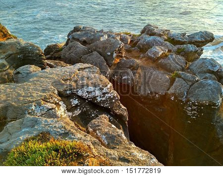 Peniche ocean rocks near Cabo Carvoeiro in sunset light, Portugal