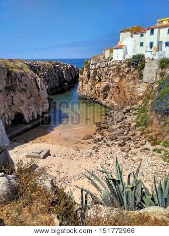 View to old houses on cliff near ocean beach in Peniche, Portugal