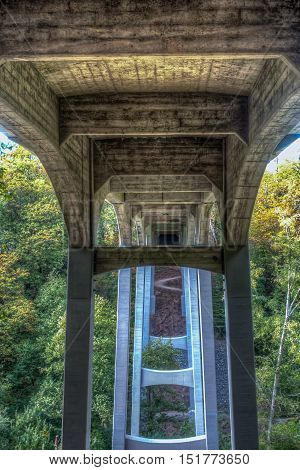 A view from beneath the bridge at Saltwater State Park in Des Moines Washington. HDR image.