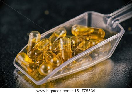 Cannabis extraction capsules infused with shatter isolated over black background