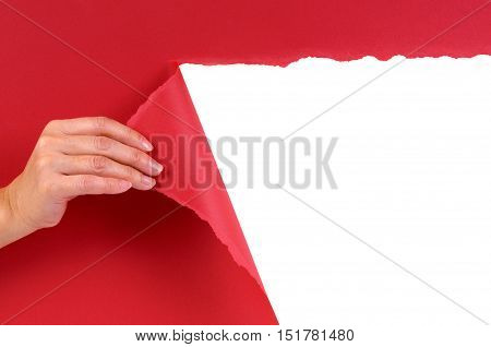 Hand Tearing Red Paper Background