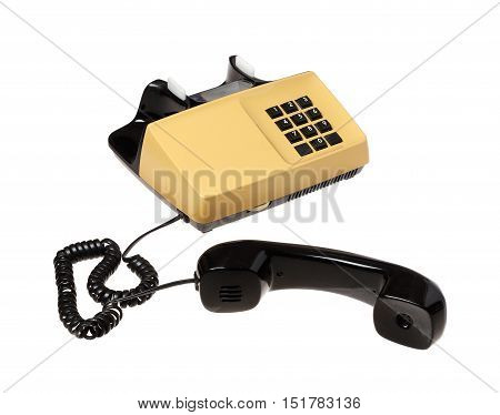 Unhooked receiver on Swedish 1970s telephone isolated on white background.