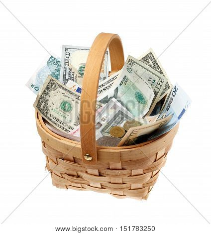 Basket filled with money in different currencies isolated on white background.