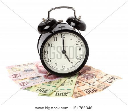 One black alaam clock on Mexican Pesos banknotes isolated on white.