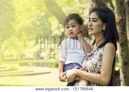 Portrait Of Young Mother And Her Son Happy Together