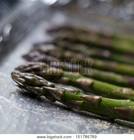 Green asparagus spears baked in the oven - a healthy food choice.