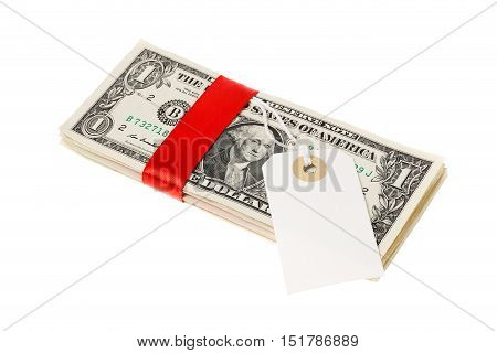 One stack of one US Dollar banknotes wraped with a red ribbon with an address label attached. Isolated on white background.