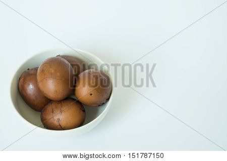 Tradional chinese herbal eggs in a white bowl