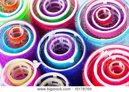 Closeup view of colorful hair rollers. Abstract background poster