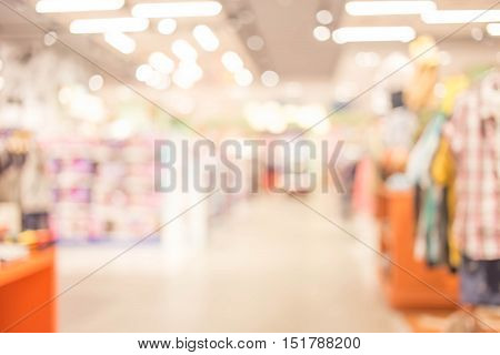 Blurred Image Of Shopping Mall And People .