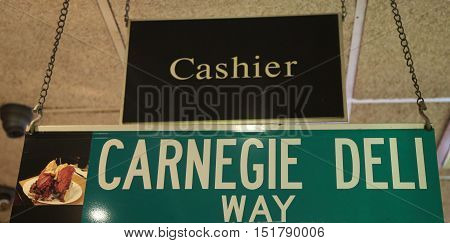 NEW YORK - OCTOBER 13, 2016: Sign at the famous Carnegie Deli in Midtown Manhattan. It was opened in 1937 adjacent to Carnegie Hall. The owner announced that it is going to close on December 31, 2016.