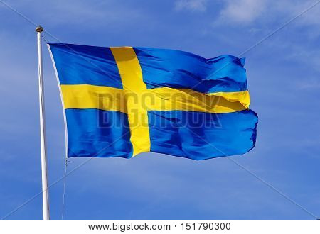 Cluse-up of the lag of Sweden on blue sky.