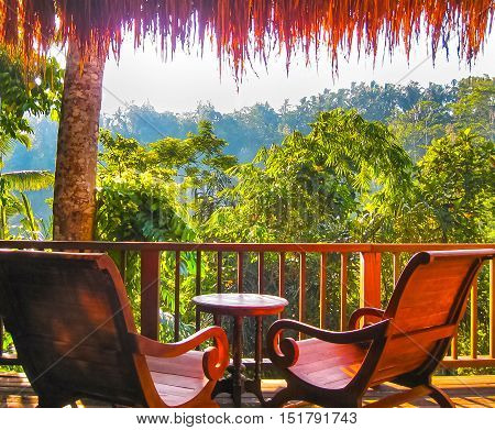 Bali, Indonesia - April 14, 2014: View of bungalow with seating at Nandini Bali Jungle Resort and Spa.