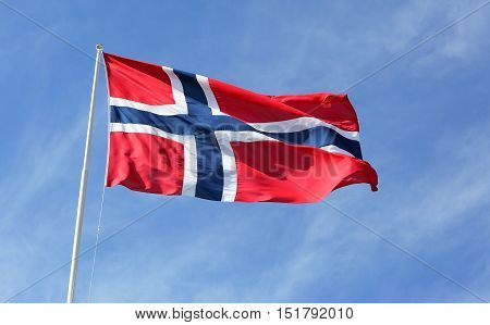 Norwegian flag against blue sky.waving in the wind.