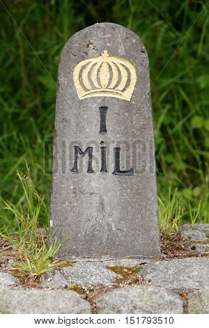 Old Swedish milestone of limestone 0.7 m tall with a crown indicates the distance one Swedish mil (10 km).