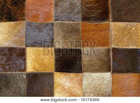 Brown animal fur made from patches and parts poster