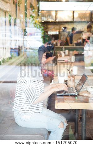 Hipster Asian Woman Using Laptop Computer.