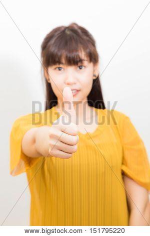 Asian Women Shown Thumb Up On White