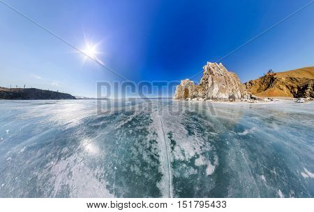 Wide-angle View Shaman Rock Or Cape Burhan On Olkhon Island In Winter, Surrounded By The Blue Ice Of
