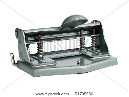 Hole punch for the Swedish double hole punched de facto standard in an older version made entirely of metal isolated on white.