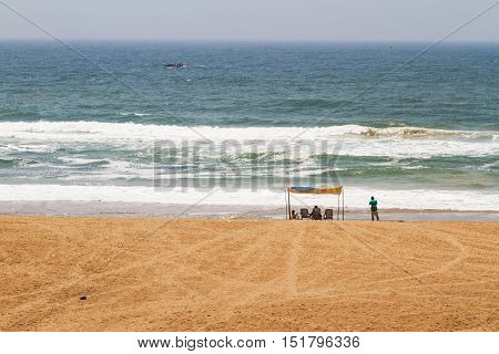 Enjoying the waves of Bay of Bengal, Puri, India