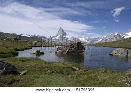 alpine lake in swiss alps during summer