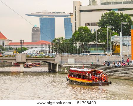 SINGAPORE, REPUBLIC OF SINGAPORE - JANUARY 10, 2014: Historical ships on the Singapore River