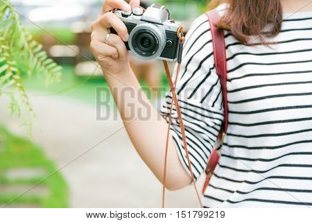 Photographer Making Pictures At Outdoor Summer Lifestyle Portrait