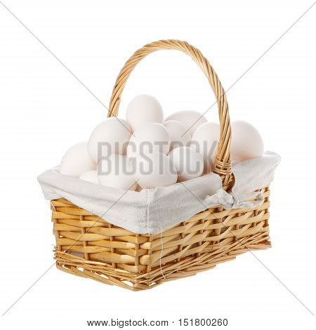 A large group of hen eggs collected in a basket with handle isolated on white background.
