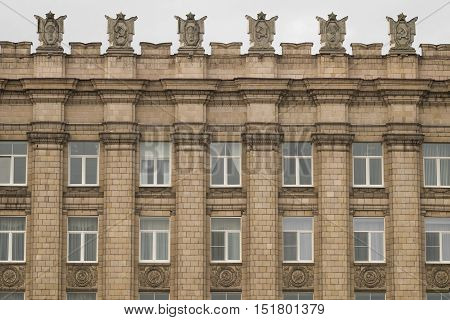 BELGOROD, RUSSIA - OCTOBER 08, 2016: Fragment of facade building administrative government Belgorod region with USSR symbols. Ornament of Stalinist architecture style.