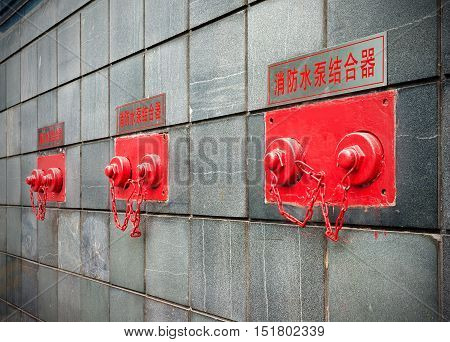 Fire pump adapter on the building wall