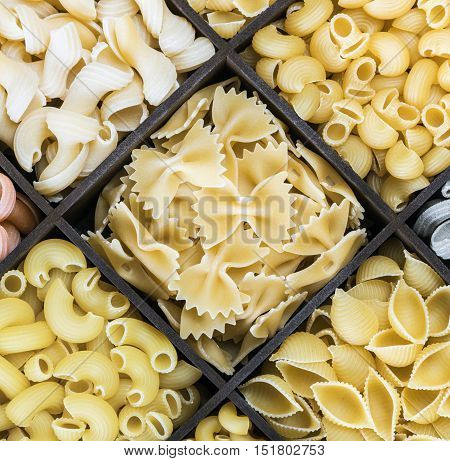 Italian pasta assortment background. Pasta in a wooden box. Italian pasta of different colors
