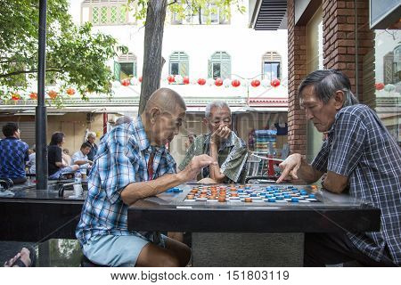 Singapore02 September 2016. Unidentified local people played chinese chess in Chinatown street market.