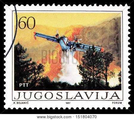 YUGOSLAVIA - CIRCA 1987 : Cancelled postage stamp printed by Yugoslavia, that shows Plane putting out fire.