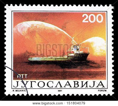 YUGOSLAVIA - CIRCA 1987 : Cancelled postage stamp printed by Yugoslavia, that shows Ship putting out fire.