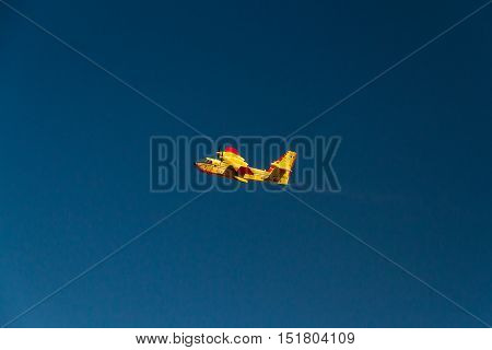 ROME - AUGUST 23: Firefighting aeroplane carrying water from Mediterranean Sea to put out fires on scrubland on August 23 2016 in Rome.