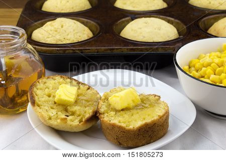 Corn muffins, corn with butter and honey