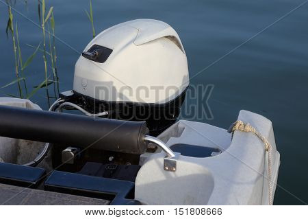 Close up of an outboard motor on a small boat.