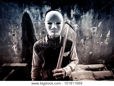A stranger wearing white mask holding hatchet,Scary background for book cover