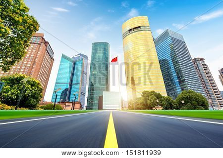 Highway leading to the Shanghai skyscraper buildings modern urban landscape exaggerated expression.