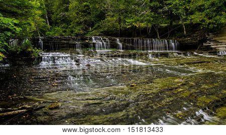 Au Train Falls. Beautiful Au Train Falls is located in Michigan's Upper Peninsula in the Hiawatha National Forest.