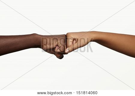 African Man Touching Knuckles With Dark-skinned Woman As Sign Of Agreement, Partnership And Cooperat