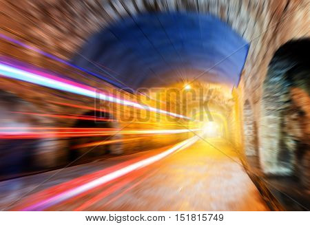 Abstract speed motion in urban highway road tunnel blurred motion toward the central. Shot from a slow moving car