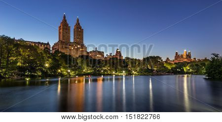 Central Park at twilight with The Lake and illuminated pathway and gazebos. Upper West Side, Manhattan, New York City